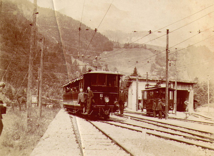 Sepia picture of two old Swiss passenger trains