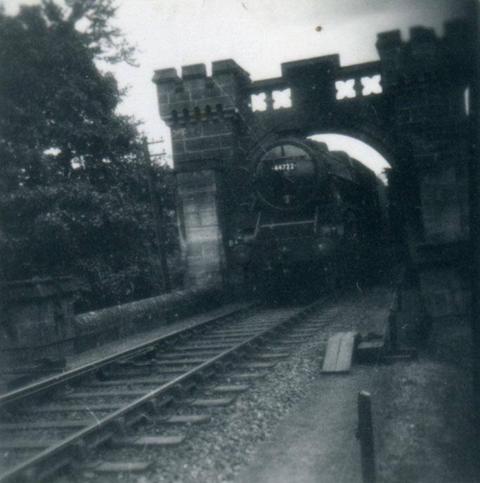 Steam Locomotive 44722 passing a bridge