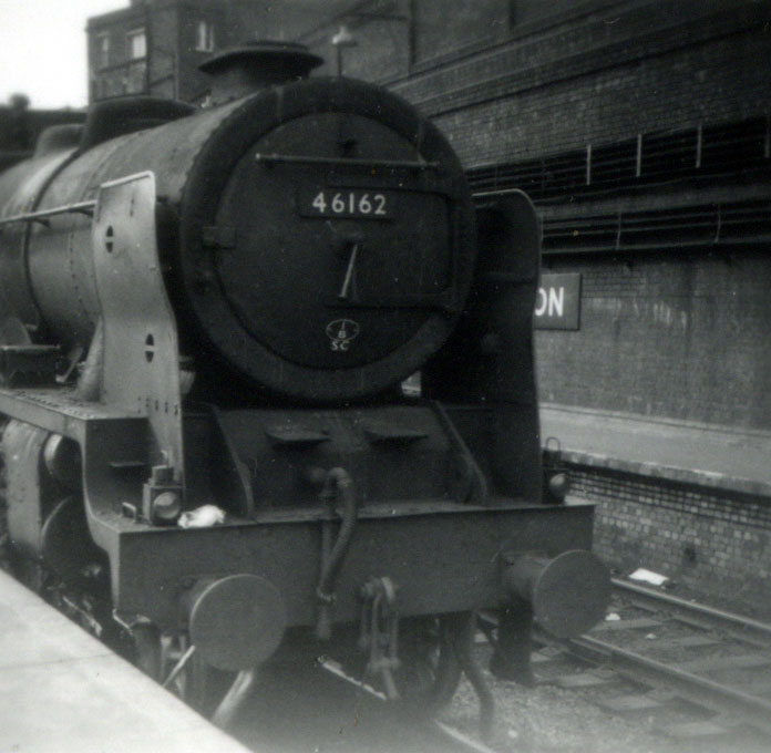 Front close up of steam train 46162